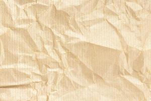 fond de texture de papier kraft froissé. couleur brun doré clair photo