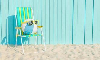 boule avec des lunettes de soleil sur la plage photo