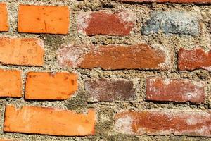 vieux murs de briques. texture abstraite du mur de briques rouges photo