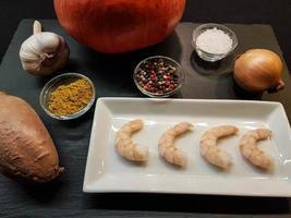 cocotte au fromage de brebis citrouille et quartiers de pommes de terre photo