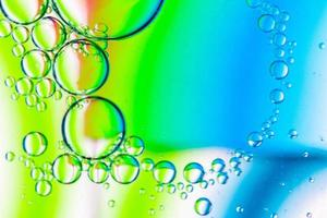 abstrait bulles d'huile sur palette vert orange cyan photo