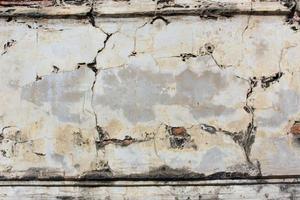 Mur de ciment en béton grunge avec fissure photo