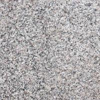 texture de pierre de granit gris foncé sans couture. photo