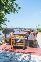 chaise et table au restaurant en terrasse avec fond vue mer photo