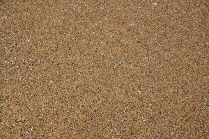 texture de sable. fond de sable. plage de sable. vue de dessus photo