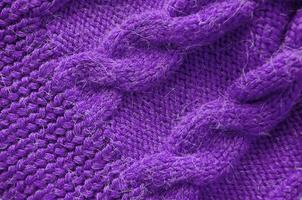 fond tricoté. texture tricotée. modèle de tricot de laine. photo