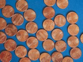 pièces d'un cent dollar, États-Unis sur bleu photo