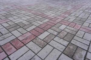motif de chaussée fait de carreaux de pavé avec surface texturée photo