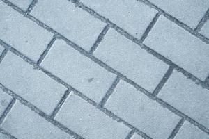 Modèle de chaussée en brique de forme rectangulaire de blocs en pierre grise photo