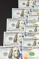texture dollar de 100, benjamin franklin et argent américain. photo