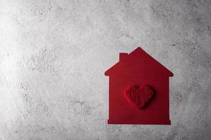 maison de papier avec un design plat de coeur. photo