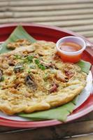 omelette aux huîtres et sauce épicée à la chinoise photo