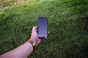 main avec smartphone moderne photo