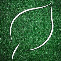 cadre en forme de feuille blanche sur l'herbe verte pour le modèle de décoration photo