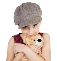 fille douce avec un ours en peluche photo