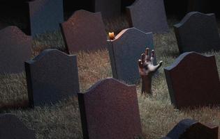 main de zombie sortant d'un cimetière photo