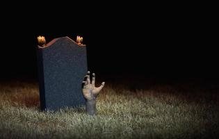main de zombie sortant de la tombe photo