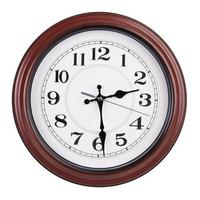 l'horloge ronde montre la moitié du troisième photo