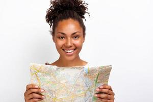 Close up portrait of a happy traveler girl with map in her hand and looking at the camera - image photo