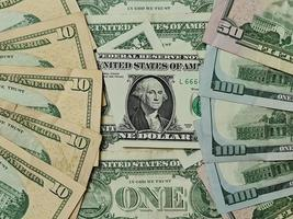 arrière-plan pour les thèmes de l'économie et de la finance avec de l'argent en dollars américains photo