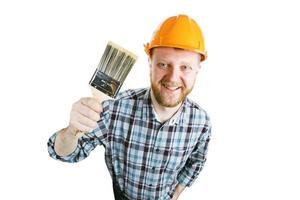 homme avec un pinceau à la main photo