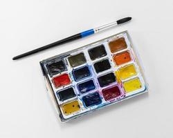 vue de dessus utilisé palette de couleurs boîte pinceau photo