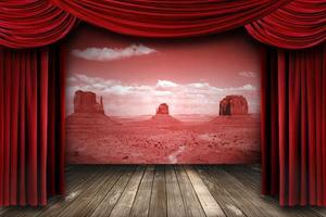 rideaux de théâtre rouge avec toile de fond de paysage désertique photo