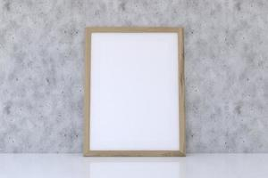 maquette de cadre en bois avec texture béton photo