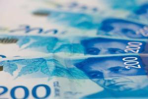 Pile de billets de banque israéliens de 200 shekel photo