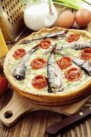 kish aux sprats et tomates cerises photo