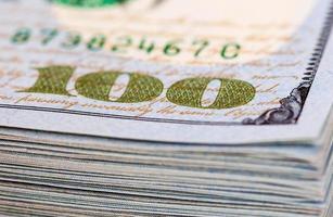 tas de billets de cent dollars bouchent photo