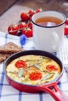 omelette aux tomates cerises photo