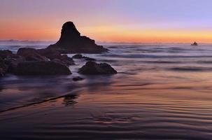 Le soleil couchant sur la plage