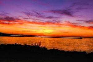 coucher de soleil phare photo