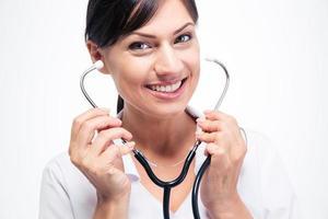 femme médecin, tenue, stéthoscope photo