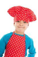 portrait en studio garçon comme petit cuisinier photo