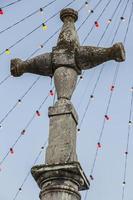 cruz de piedra, plaza del ayuntamiento de pastrana, en fiestas photo