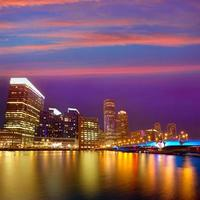 Boston sunset skyline at fan pier massachusetts photo