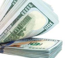 tas de billets de cent dollars bouchent