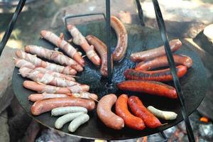 cuisson des saucisses photo