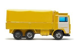 camion jouet de couleur jaune et blanc
