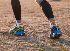 détail, pieds, coureur, piste photo