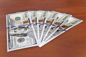 concept de l'argent - plusieurs billets en dollars photo