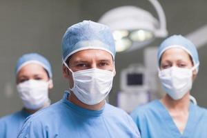 équipe médicale, regarder appareil-photo