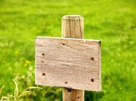 signe de plaque en bois photo