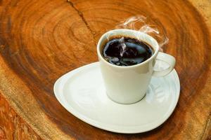 tasse à café sur un fond de bois.