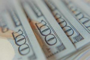 pile de billets de cent dollars macro photo