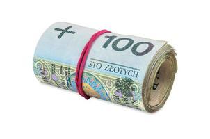 Billets polonais de 100 pln roulés avec du caoutchouc photo
