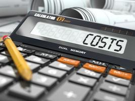 concept de calcul des coûts, calculatrice. photo
