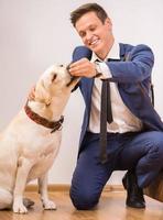 homme affaires, chien photo
